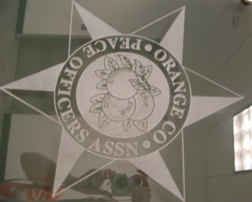 Glass Signs for Peace Officers Standards and Training Commission